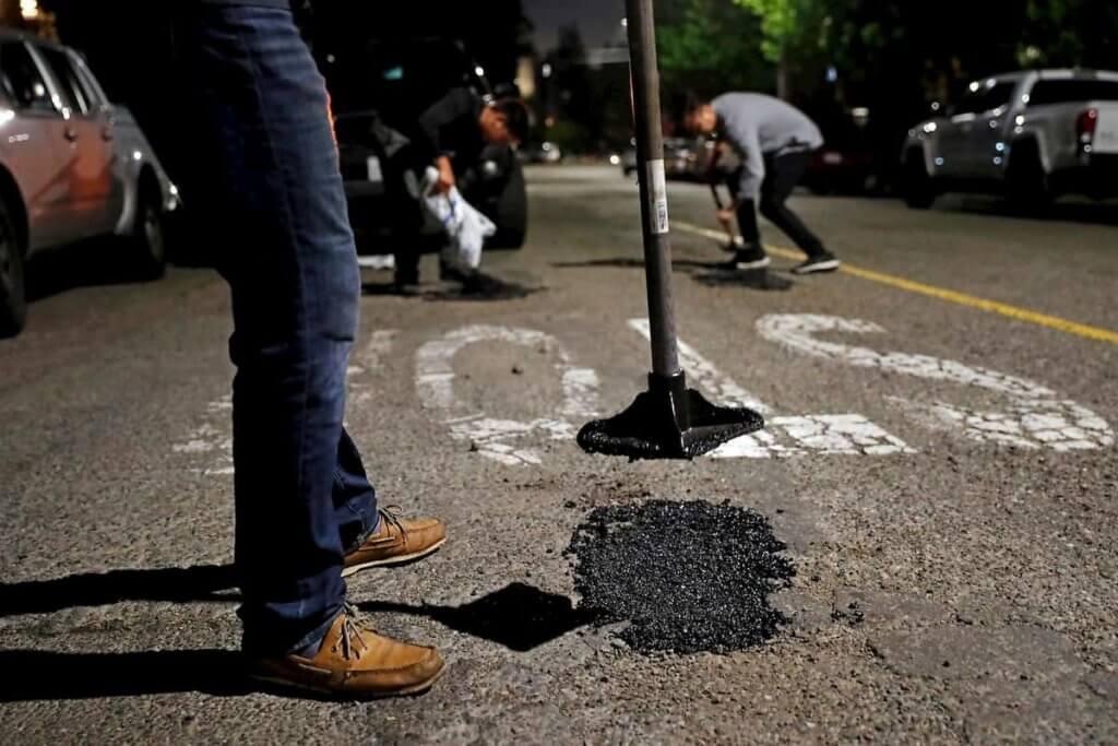 Filling in potholes or dents